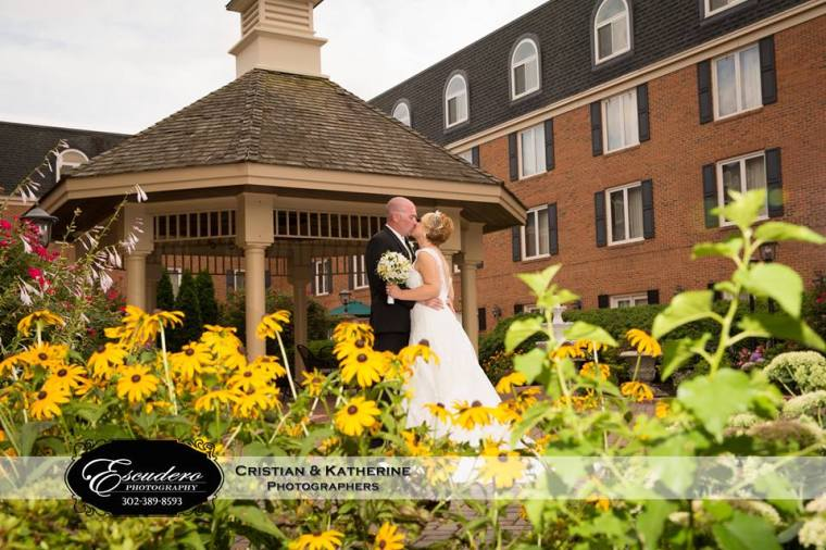 Escudero Hilton Christiana bride groom kiss black eye susans