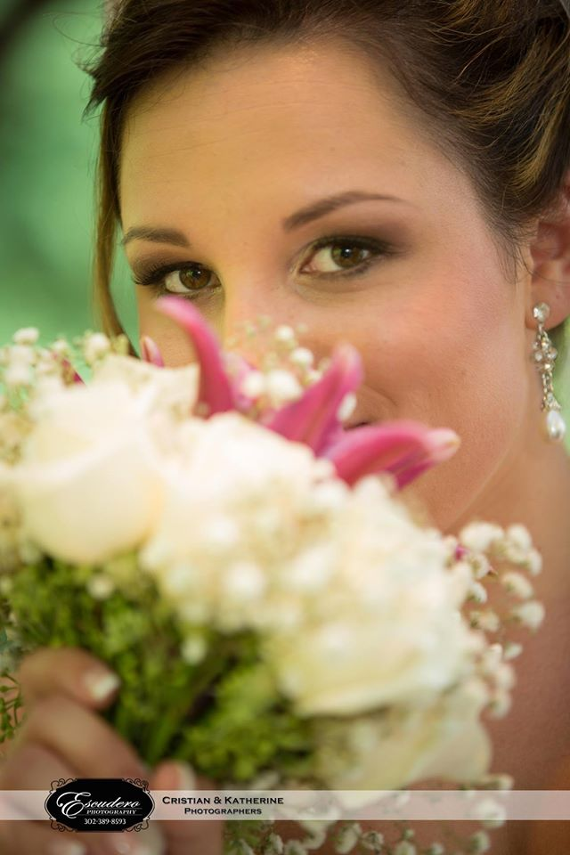 Escudero Photography bride smelling bouquet at Farmhouse