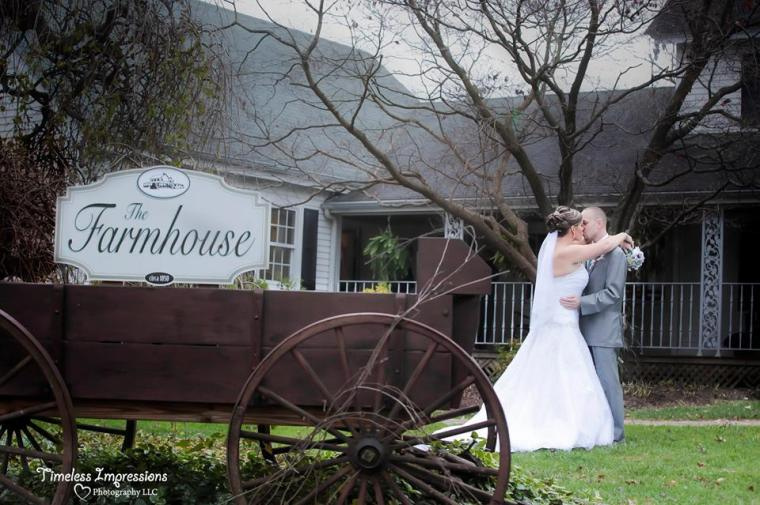 Farmhouse fairytale wedding kiss outside