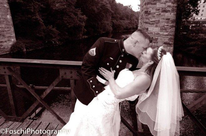 Foschi Marine and bride kiss