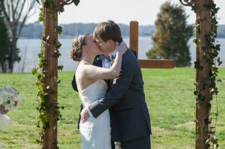 Linton red barn wedding kiss