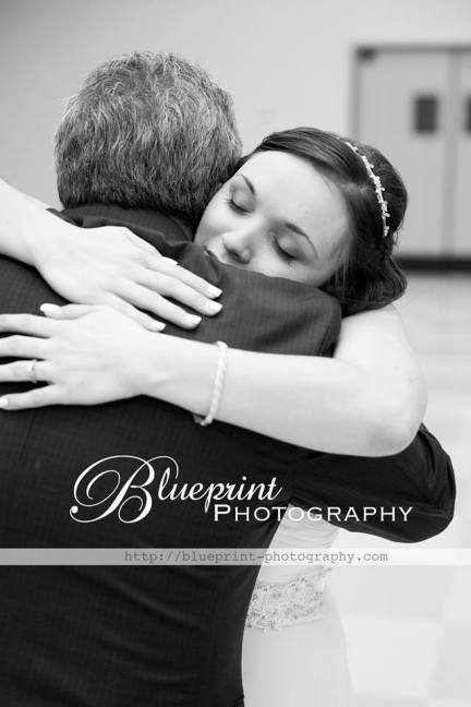 Blueprint photography jenga wedding hug father