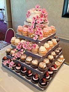 Half baked spring wedding cake and cupcakes