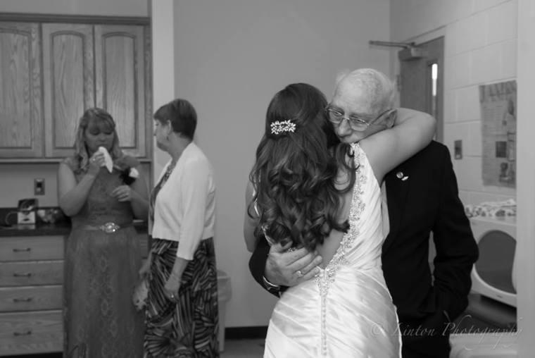 Linton Millstad Center Wedding bride hugging grandfather