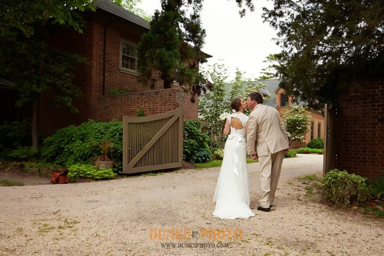 Great Oak Manor blue bride and groom at the gate