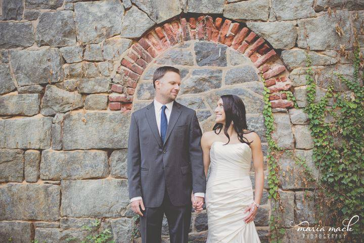 Hagley wedding fairytale birde groom in front of stone and brick wall