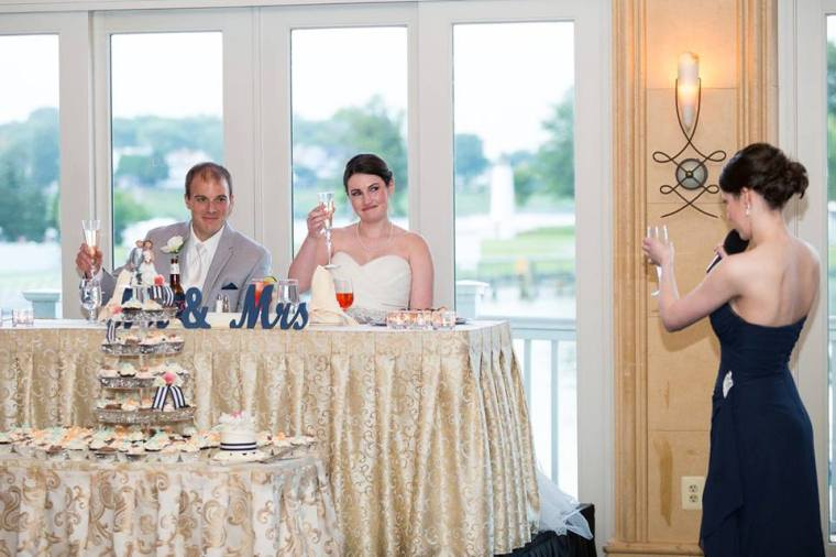Chesapeake Inn Ballroom stars bride groom cheers
