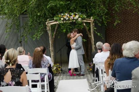 Foschi summer field wedding the ceremony kiss