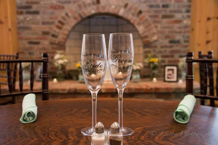 Linton and Heritage wedding glasses and fireplace