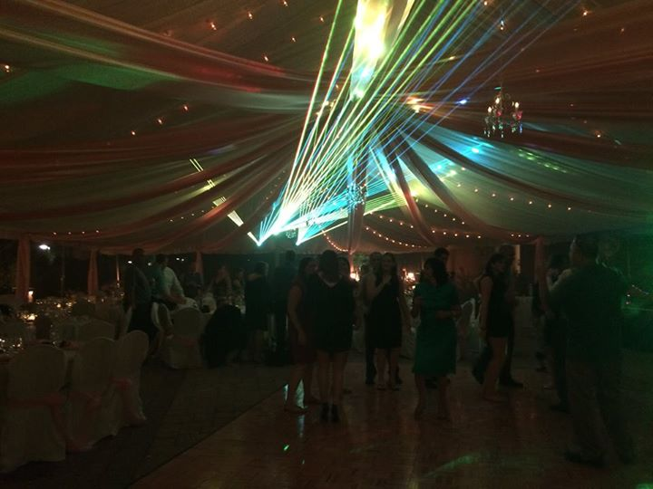 Executive wedding night reception under tent and lights