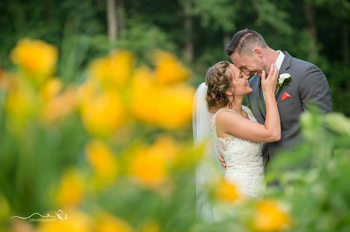 Maple Dale wedding bride and groom in flowers