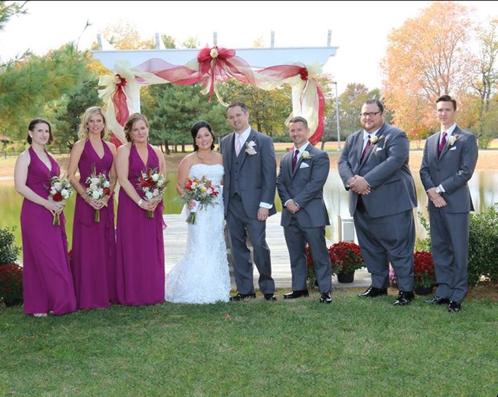 Baker Barn wedding bridal party and arch