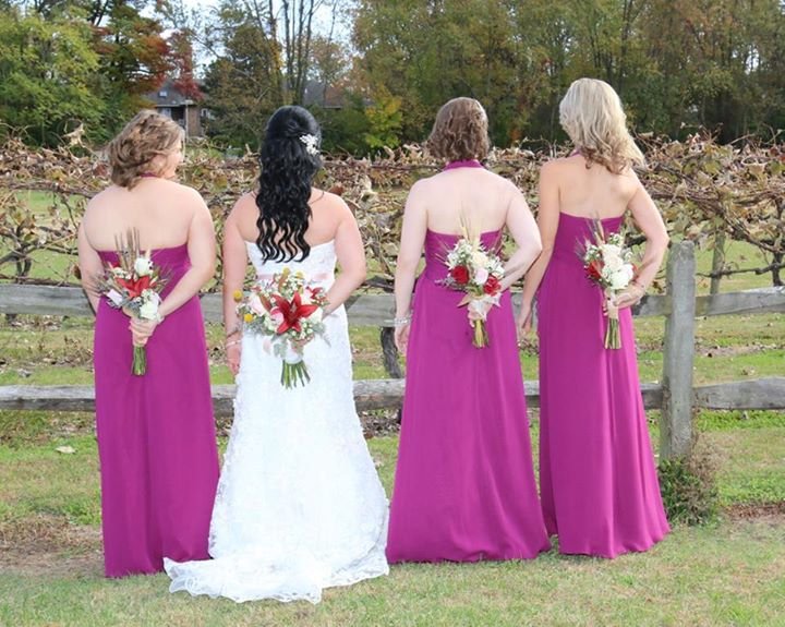 BAker Barn wedding bride and maids back flowers