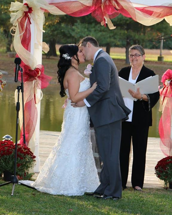 Baker Barn wedding  ceremony kiss