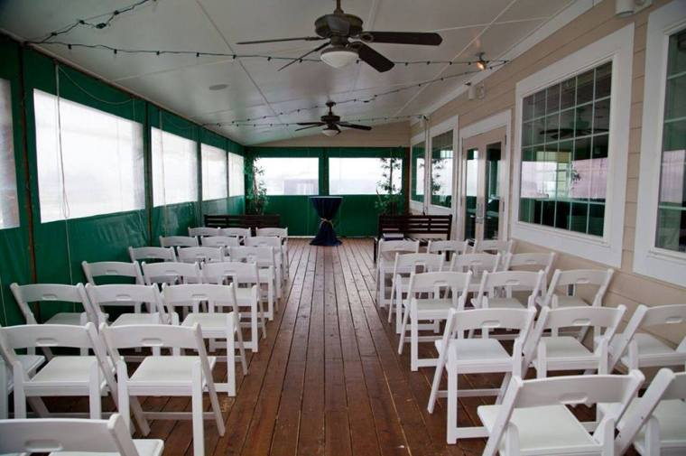 Irish Eyes Dover Rent Nautical Wedding porch ceremony setting