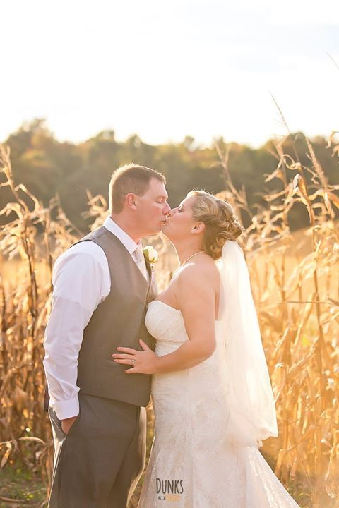 Louis Marie Bridal wedding bride and groom kiss in cornfield