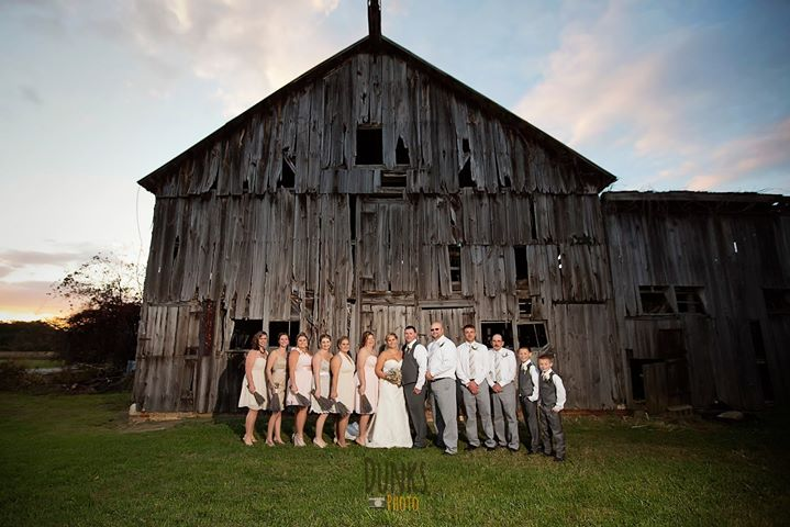 Louis Marie Bridal wedding whole party in front of barn