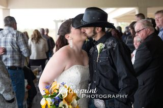 Blueprint cowboy wedding white clay creek close kiss