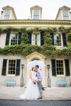Hagley Fantail Manor House wedding couple umbrella door