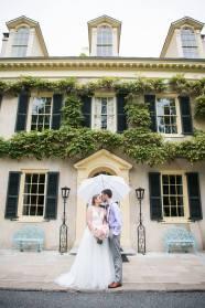 Hagley Fantail Manor House wedding couple umbrella door