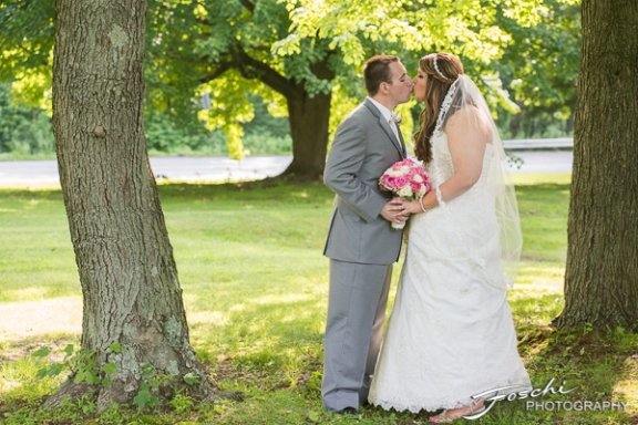 Foschi Orner Bride and Groom kiss under trees