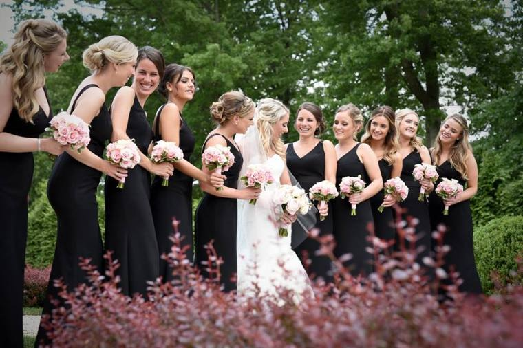 Kerry Harrison nemours waterfall wedding bridal party in garden laughing