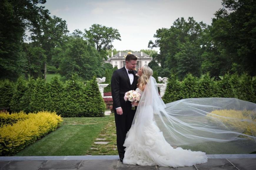 Kerry Harrison NEmours waterfall wedding bride groom garden manor house blowing veil