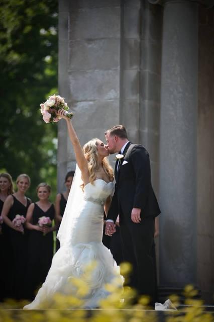 Kerry Harrison Nemours Waterfall wedding bride groom kiss columns bouquet high