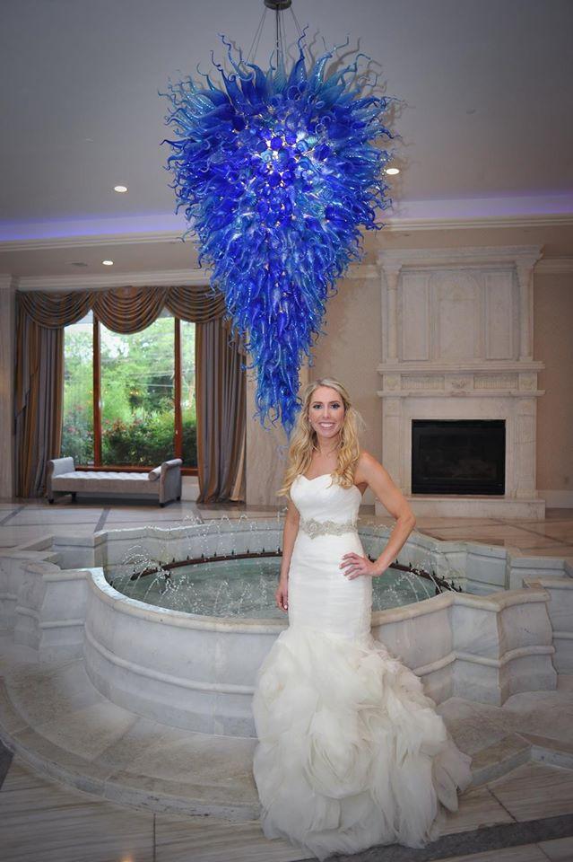 Kerry Harrison nemours waterfall wedding bride with blue chandelier
