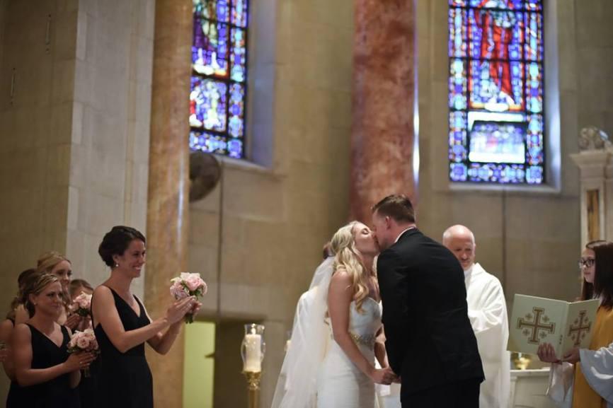 Kerry Harrison nemours waterfall wedding kiss at altar