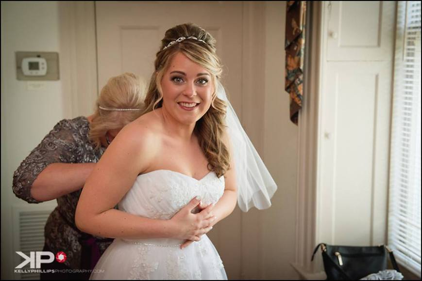 Kelly Phillips Whist bride getting in dress