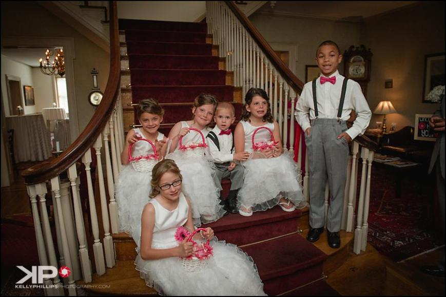 Kelly Phillips Whist flower girls, boys on stairs