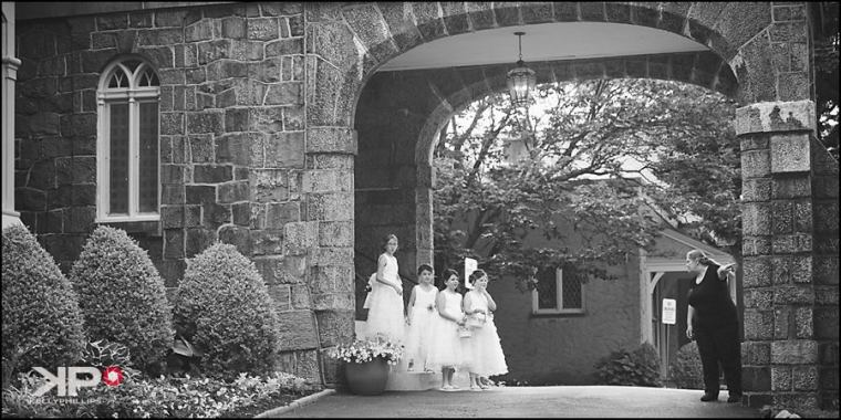 Kelly Phillips Whist flower girls waiting in the stone arch