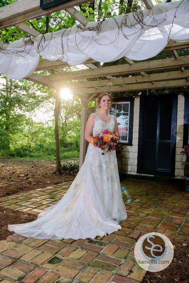 Nassau Valley Sam Ellis bride under trellis drape