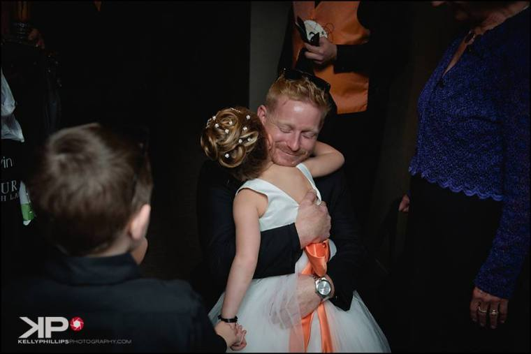 kelly-phillips-erica-austin-flower-girl-hugs-from-groom